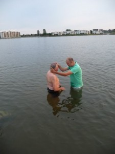 Torben baptizing his father